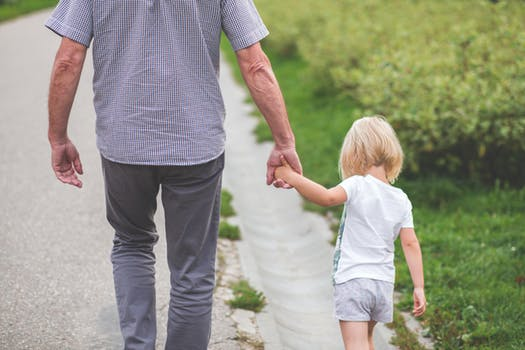 Man and child walking hand in hand