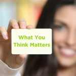 "woman holding card that says ""what you think matters"""
