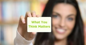 """woman holding card that says """"what you think matters"""""""